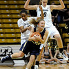 "University of Colorado's Brittany Wilson, left, and Rachel Hargis double team Northern Colorado's Amy Marin during the first round of the 2012 Women's NIT tournament on Wednesday, March 14, at the Coors Event Center on the CU campus in Boulder. CU won the game 54-40. For more photos and video of the game go to  <a href=""http://www.dailycamera.com"">http://www.dailycamera.com</a><br /> Jeremy Papasso/ Camera"