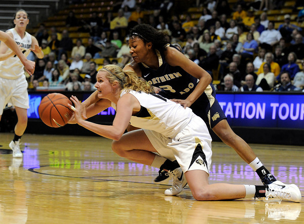 "University of Colorado's Julie Seabrook fights to make a pass under the arms of Northern Colorado's D'Shara Strange during the first round of the 2012 Women's NIT tournament on Wednesday, March 14, at the Coors Event Center on the CU campus in Boulder. For more photos and video of the game go to  <a href=""http://www.dailycamera.com"">http://www.dailycamera.com</a><br /> Jeremy Papasso/ Camera"