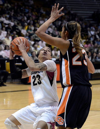 "University of Colorado's Chucky Jeffery pump fakes ShaKiana Edwards-Teasley while going for a shot during a game against Oregon State on Friday, Feb. 8, at the Coors Event Center on the CU campus in Boulder. For more photos of the game go to  <a href=""http://www.dailycamera.com"">http://www.dailycamera.com</a><br /> Jeremy Papasso/ Camera"