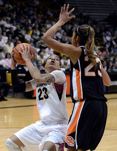 University of Colorado's Chucky Jeffery pump fakes ShaKiana Edwards-Teasley while going for a shot during a game against Oregon State on Friday, Feb. 8, at the Coors Event Center on the CU campus in Boulder. For more photos of the game go to www.dailycamera.com Jeremy Papasso/ Camera