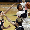 """University of Colorado's Brittany Wilson takes a shot over Ali Gibson, center, and Mollee Schwegler, at left, during a game against Oregon State on Friday, Feb. 8, at the Coors Event Center on the CU campus in Boulder. For more photos of the game go to  <a href=""""http://www.dailycamera.com"""">http://www.dailycamera.com</a><br /> Jeremy Papasso/ Camera"""