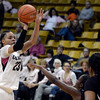 "University of Colorado's Chucky Jeffery shoots a three-pointer over a swarm of defenders during a game against Oregon State on Friday, Feb. 8, at the Coors Event Center on the CU campus in Boulder. CU won the game 61-47. For more photos of the game go to  <a href=""http://www.dailycamera.com"">http://www.dailycamera.com</a><br /> Jeremy Papasso/ Camera"
