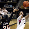 "University of Colorado's Chucky Jeffery takes a shot over Alyssa Martin during a game against Oregon State on Friday, Feb. 8, at the Coors Event Center on the CU campus in Boulder. For more photos of the game go to  <a href=""http://www.dailycamera.com"">http://www.dailycamera.com</a><br /> Jeremy Papasso/ Camera"