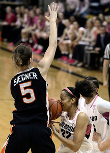 University of Colorado's Arielle Roberson takes a ball to the face while driving to the hoop against Samantha Siegner during a game against Oregon State on Friday, Feb. 8, at the Coors Event Center on the CU campus in Boulder. For more photos of the game go to www.dailycamera.com Jeremy Papasso/ Camera