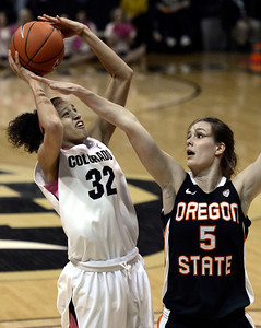 University of Colorado's Arielle Roberson takes a shot over Samantha Siegner during a game against Oregon State on Friday, Feb. 8, at the Coors Event Center on the CU campus in Boulder. For more photos of the game go to www.dailycamera.com Jeremy Papasso/ Camera