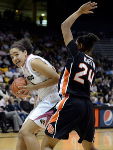 University of Colorado's Jamee Swan drives to the hoop against Alyssa Martin during a game against Oregon State on Friday, Feb. 8, at the Coors Event Center on the CU campus in Boulder. For more photos of the game go to www.dailycamera.com Jeremy Papasso/ Camera