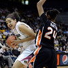 "University of Colorado's Jamee Swan drives to the hoop against Alyssa Martin during a game against Oregon State on Friday, Feb. 8, at the Coors Event Center on the CU campus in Boulder. For more photos of the game go to  <a href=""http://www.dailycamera.com"">http://www.dailycamera.com</a><br /> Jeremy Papasso/ Camera"
