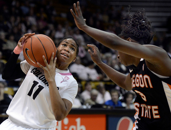 "University of Colorado's Brittany Wilson drives to the hoop in front of Khadidja Toure during a game against Oregon State on Friday, Feb. 8, at the Coors Event Center on the CU campus in Boulder. For more photos of the game go to  <a href=""http://www.dailycamera.com"">http://www.dailycamera.com</a><br /> Jeremy Papasso/ Camera"
