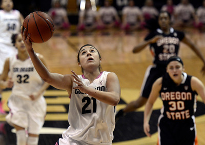 University of Colorado's Jasmine Sborov drives to the hoop in front of Mollee Schwegler, No. 30, during a game against Oregon State on Friday, Feb. 8, at the Coors Event Center on the CU campus in Boulder. For more photos of the game go to www.dailycamera.com Jeremy Papasso/ Camera