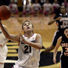 "University of Colorado's Jasmine Sborov drives to the hoop in front of Mollee Schwegler, No. 30, during a game against Oregon State on Friday, Feb. 8, at the Coors Event Center on the CU campus in Boulder. For more photos of the game go to  <a href=""http://www.dailycamera.com"">http://www.dailycamera.com</a><br /> Jeremy Papasso/ Camera"