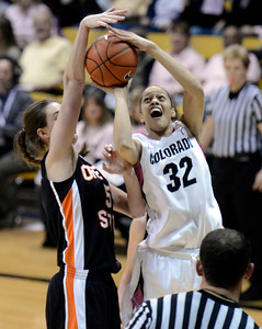 University of Colorado's Arielle Roberson gets her shot blocked by Samantha Siegner during a game against Oregon State on Friday, Feb. 8, at the Coors Event Center on the CU campus in Boulder. CU won the game 61-47. For more photos of the game go to www.dailycamera.com Jeremy Papasso/ Camera