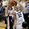 "University of Colorado's Arielle Roberson gets her shot blocked by Samantha Siegner during a game against Oregon State on Friday, Feb. 8, at the Coors Event Center on the CU campus in Boulder. CU won the game 61-47. For more photos of the game go to  <a href=""http://www.dailycamera.com"">http://www.dailycamera.com</a><br /> Jeremy Papasso/ Camera"