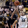 "University of Colorado's Jamee Swan gets fouled by Ali Gibson, No. 14, while going for a shot during a game against Oregon State on Friday, Feb. 8, at the Coors Event Center on the CU campus in Boulder. CU won the game 61-47. For more photos of the game go to  <a href=""http://www.dailycamera.com"">http://www.dailycamera.com</a><br /> Jeremy Papasso/ Camera"