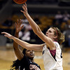 """University of Colorado's Rachel Hargis takes a shot over Patricia Bright during a game against Oregon State on Friday, Feb. 8, at the Coors Event Center on the CU campus in Boulder. For more photos of the game go to  <a href=""""http://www.dailycamera.com"""">http://www.dailycamera.com</a><br /> Jeremy Papasso/ Camera"""