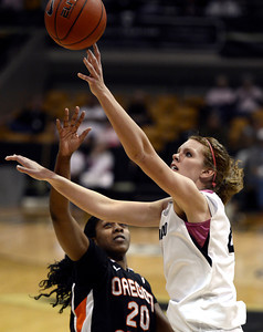 University of Colorado's Rachel Hargis takes a shot over Patricia Bright during a game against Oregon State on Friday, Feb. 8, at the Coors Event Center on the CU campus in Boulder. For more photos of the game go to www.dailycamera.com Jeremy Papasso/ Camera