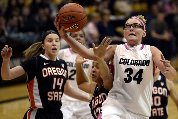 """University of Colorado's Jen Reese goes for a layup over Deven Hunter, at center, during a game against Oregon State on Friday, Feb. 8, at the Coors Event Center on the CU campus in Boulder. For more photos of the game go to  <a href=""""http://www.dailycamera.com"""">http://www.dailycamera.com</a><br /> Jeremy Papasso/ Camera"""