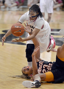 University of Colorado's Ashley Wilson fights for a loose ball with ShaKiana Edwards-Teasley during a game against Oregon State on Friday, Feb. 8, at the Coors Event Center on the CU campus in Boulder. CU won the game 61-47. For more photos of the game go to www.dailycamera.com Jeremy Papasso/ Camera
