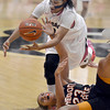 "University of Colorado's Ashley Wilson fights for a loose ball with ShaKiana Edwards-Teasley during a game against Oregon State on Friday, Feb. 8, at the Coors Event Center on the CU campus in Boulder. CU won the game 61-47. For more photos of the game go to  <a href=""http://www.dailycamera.com"">http://www.dailycamera.com</a><br /> Jeremy Papasso/ Camera"