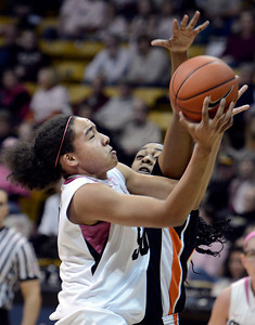 University of Colorado's Jamee Swan goes for a layup over Patricia Bright during a game against Oregon State on Friday, Feb. 8, at the Coors Event Center on the CU campus in Boulder. CU won the game 61-47. For more photos of the game go to www.dailycamera.com Jeremy Papasso/ Camera