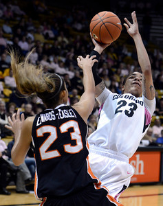 University of Colorado's Chucky Jeffery takes a shot over ShaKiana Edwards-Teasley during a game against Oregon State on Friday, Feb. 8, at the Coors Event Center on the CU campus in Boulder. For more photos of the game go to www.dailycamera.com Jeremy Papasso/ Camera