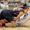 "Gabrielle Clark, left, of San Diego State, wrestles for the ball with Meagan Malcolm-Peck of Colorado during the second half of the 26th Annual Omni Hotels Classic in Boulder, Colorado, on November 24, 2012.<br /> For more photos of the game, go to  <a href=""http://www.dailycamera.com"">http://www.dailycamera.com</a>.<br /> Cliff Grassmick / November 24, 2012"