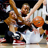 "Chucky Jeffery, left, of Colorado, and Deajanae Scurry of San Diego State, wrestle for the ball during the first half of the 26th Annual Omni Hotels Classic in Boulder, Colorado, on November 24, 2012.<br /> For more photos of the game, go to  <a href=""http://www.dailycamera.com"">http://www.dailycamera.com</a>.<br /> Cliff Grassmick / November 24, 2012"