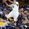 "Brittany Wilson of Colorado gets a layup past Chelsea Hopkins of San Diego State during the first half of the 26th Annual Omni Hotels Classic in Boulder, Colorado, on November 24, 2012.<br /> For more photos of the game, go to  <a href=""http://www.dailycamera.com"">http://www.dailycamera.com</a>.<br /> Cliff Grassmick / November 24, 2012"