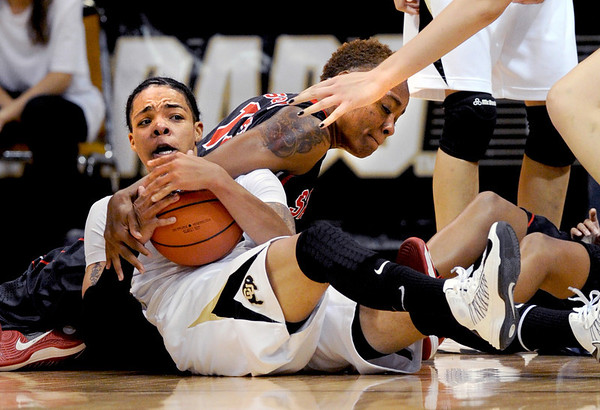 """Chucky Jeffery, left, of Colorado, and Deajanae Scurry of San Diego State, wrestle for the ball during the first half of the 26th Annual Omni Hotels Classic in Boulder, Colorado, on November 24, 2012.<br /> For more photos of the game, go to  <a href=""""http://www.dailycamera.com"""">http://www.dailycamera.com</a>.<br /> Cliff Grassmick / November 24, 2012"""