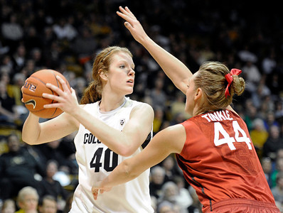 University of Colorado's Rachel Hargis looks to pass the ball over Joslyn Tinkle during a game against Stanford on Friday, Jan. 4, at the Coors Event Center on the CU campus in Boulder. For more photos of the game go to www.dailycamera.com Jeremy Papasso/ Camera
