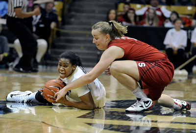 University of Colorado's Ashley Wilson fights for a loose ball with Mikaela Ruef during a game against Stanford on Friday, Jan. 4, at the Coors Event Center on the CU campus in Boulder. For more photos of the game go to www.dailycamera.com Jeremy Papasso/ Camera