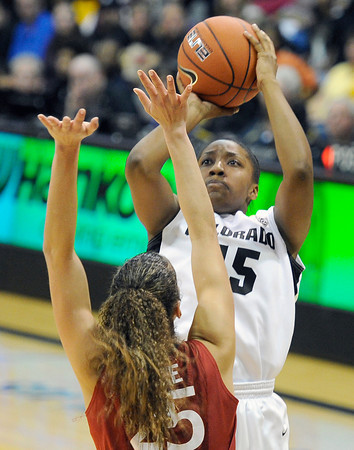 "University of Colorado's Kyleesha Weston takes a shot over Erica Payne during a game against Stanford on Friday, Jan. 4, at the Coors Event Center on the CU campus in Boulder. For more photos of the game go to  <a href=""http://www.dailycamera.com"">http://www.dailycamera.com</a><br /> Jeremy Papasso/ Camera"