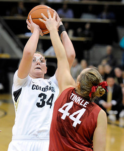 University of Colorado's Jen Reese takes a shot over Joslyn Tinkle during a game against Stanford on Friday, Jan. 4, at the Coors Event Center on the CU campus in Boulder. For more photos of the game go to www.dailycamera.com Jeremy Papasso/ Camera