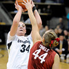 "University of Colorado's Jen Reese takes a shot over Joslyn Tinkle during a game against Stanford on Friday, Jan. 4, at the Coors Event Center on the CU campus in Boulder. For more photos of the game go to  <a href=""http://www.dailycamera.com"">http://www.dailycamera.com</a><br /> Jeremy Papasso/ Camera"