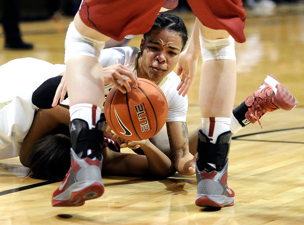 "University of Colorado's Chucky Jeffery fights for a loose ball during a game against Stanford on Friday, Jan. 4, at the Coors Event Center on the CU campus in Boulder. For more photos of the game go to  <a href=""http://www.dailycamera.com"">http://www.dailycamera.com</a><br /> Jeremy Papasso/ Camera"