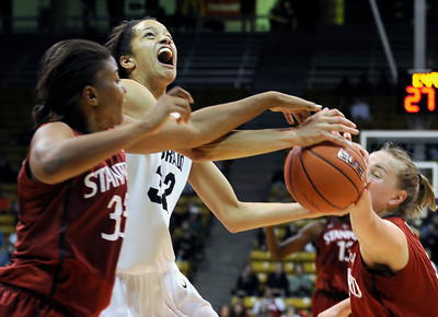 University of Colorado's Arielle Roberson gets fouled by Amber Orrange, left, during a game against Stanford on Friday, Jan. 4, at the Coors Event Center on the CU campus in Boulder. For more photos of the game go to www.dailycamera.com Jeremy Papasso/ Camera