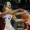 "University of Colorado's Arielle Roberson gets fouled by Amber Orrange, left, during a game against Stanford on Friday, Jan. 4, at the Coors Event Center on the CU campus in Boulder. For more photos of the game go to  <a href=""http://www.dailycamera.com"">http://www.dailycamera.com</a><br /> Jeremy Papasso/ Camera"