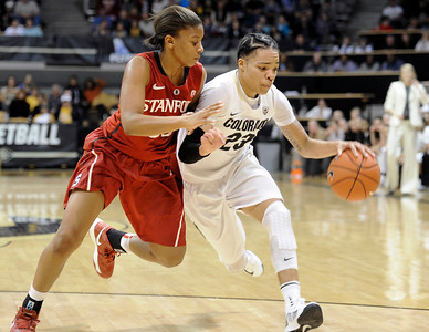 University of Colorado's Chucky Jeffery dribbles past Amber Orrange during a game against Stanford on Friday, Jan. 4, at the Coors Event Center on the CU campus in Boulder. For more photos of the game go to www.dailycamera.com Jeremy Papasso/ Camera