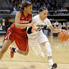 "University of Colorado's Chucky Jeffery dribbles past Amber Orrange during a game against Stanford on Friday, Jan. 4, at the Coors Event Center on the CU campus in Boulder. For more photos of the game go to  <a href=""http://www.dailycamera.com"">http://www.dailycamera.com</a><br /> Jeremy Papasso/ Camera"