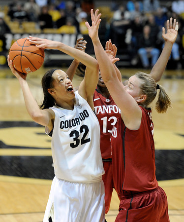 "University of Colorado's Arielle Roberson takes a shot over Mikaela Ruef, right, during a game against Stanford on Friday, Jan. 4, at the Coors Event Center on the CU campus in Boulder. For more photos of the game go to  <a href=""http://www.dailycamera.com"">http://www.dailycamera.com</a><br /> Jeremy Papasso/ Camera"
