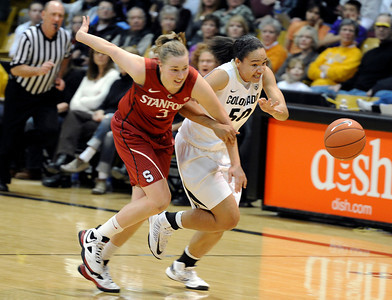 University of Colorado's Jamee Swan fights for a loose ball with Mikaela Ruef during a game against Stanford on Friday, Jan. 4, at the Coors Event Center on the CU campus in Boulder. For more photos of the game go to www.dailycamera.com Jeremy Papasso/ Camera