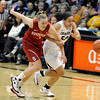 "University of Colorado's Jamee Swan fights for a loose ball with Mikaela Ruef during a game against Stanford on Friday, Jan. 4, at the Coors Event Center on the CU campus in Boulder. For more photos of the game go to  <a href=""http://www.dailycamera.com"">http://www.dailycamera.com</a><br /> Jeremy Papasso/ Camera"