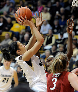 University of Colorado's Arielle Roberson takes a shot over Chiney Ogwumike, and Mikaela Ruef, No. 3, during a game against Stanford on Friday, Jan. 4, at the Coors Event Center on the CU campus in Boulder. For more photos of the game go to www.dailycamera.com Jeremy Papasso/ Camera