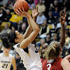 "University of Colorado's Arielle Roberson takes a shot over Chiney Ogwumike, and Mikaela Ruef, No. 3, during a game against Stanford on Friday, Jan. 4, at the Coors Event Center on the CU campus in Boulder. For more photos of the game go to  <a href=""http://www.dailycamera.com"">http://www.dailycamera.com</a><br /> Jeremy Papasso/ Camera"