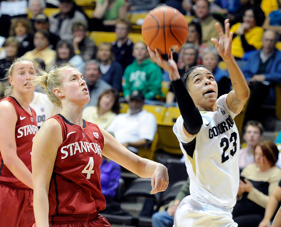 "University of Colorado's Chucky Jeffery takes a shot in front of Taylor Greenfield during a game against Stanford on Friday, Jan. 4, at the Coors Event Center on the CU campus in Boulder. For more photos of the game go to  <a href=""http://www.dailycamera.com"">http://www.dailycamera.com</a><br /> Jeremy Papasso/ Camera"