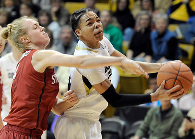 University of Colorado's Chucky Jeffery goes for a layup in front of Taylor Greenfield during a game against Stanford on Friday, Jan. 4, at the Coors Event Center on the CU campus in Boulder. For more photos of the game go to www.dailycamera.com Jeremy Papasso/ Camera