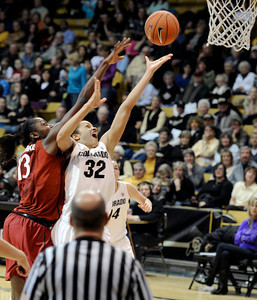 University of Colorado's Arielle Roberson goes for a lay-up under the hands of Chiney Ogwumike during a game against Stanford on Friday, Jan. 4, at the Coors Event Center on the CU campus in Boulder. For more photos of the game go to www.dailycamera.com Jeremy Papasso/ Camera