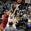 "University of Colorado's Arielle Roberson goes for a lay-up under the hands of Chiney Ogwumike during a game against Stanford on Friday, Jan. 4, at the Coors Event Center on the CU campus in Boulder. For more photos of the game go to  <a href=""http://www.dailycamera.com"">http://www.dailycamera.com</a><br /> Jeremy Papasso/ Camera"