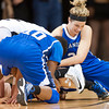 S1124CUBASKET5<br /> CU's #34, Jen Reese and Texas A&M's #10, Janae Blount and #30, Morgan Schwartz fight for a loose ball during CU's 75-48 win at the Coors Event Center in Boulder Colorado on Friday evening, November 23rd, 2012.<br /> <br /> Photo by: Jonathan Castner