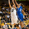 S1124CUBASKET1<br /> CU's #32, Arielle Roberson, puts one up and in as Texas A&M's #21, Jessica Jammer defends during CU's 75-48 win at the Coors Event Center in Boulder Colorado on Friday evening, November 23rd, 2012.<br /> <br /> Photo by: Jonathan Castner