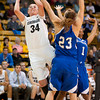 S1124CUBASKET10<br /> CU's #34, Jen Reese, puts one up and in as Texas A&M's #23, Brandi Huff and #1, Trish Amoboree, defends during CU's 75-48 win at the Coors Event Center in Boulder Colorado on Friday evening, November 23rd, 2012.<br /> <br /> Photo by: Jonathan Castner